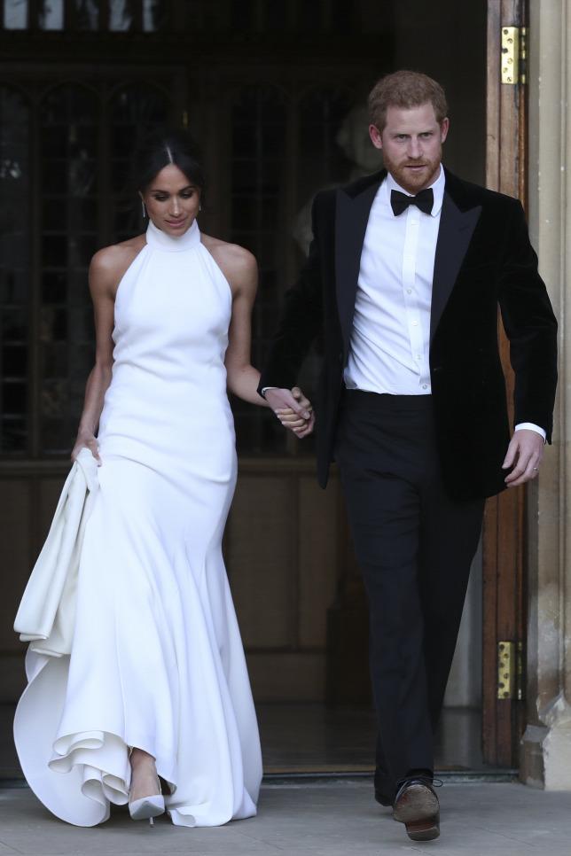 10b6bcd460 Harry Herceg és Meghan Markle a második ruhájukbanForrás: AFP/Steve Parsons